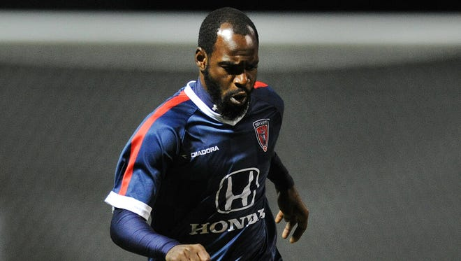 Indy Eleven midfielder Don Smart pushes the ball up field against the Chicago Fire reserve team at the Boilermaker Soccer Complex, Tuesday, April 1, 2014, in West Lafayette. The Chicago Fire won the game 3-1.
