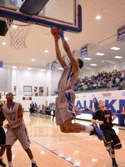Faulkner's Cortez Riley flies in for a dunk in Thursday night's game against AUM.