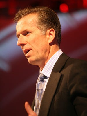 Don Walker, Co-CEO of Magna International, speaks at the Automotive News World Congress at the Mariott Renaissance Center in Detroit in 2010.
