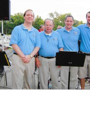 Neil Copley, left, with the Indiana Wind Symphony trombone