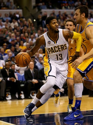 Indiana Pacers forward Paul George (13) drives the baseline against the Golden State Warriors at Bankers Life Fieldhouse on Dec. 7, 2015.