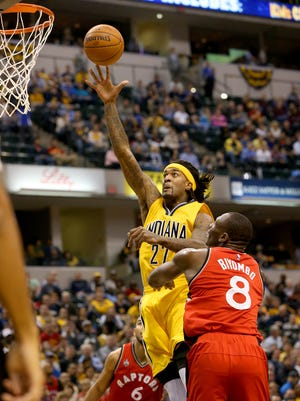 Indiana Pacers center Jordan Hill (27) drives a hits a jumper over Toronto Raptors center Bismack Biyombo (8) at Bankers Life Fieldhouse on Dec. 14, 2015.