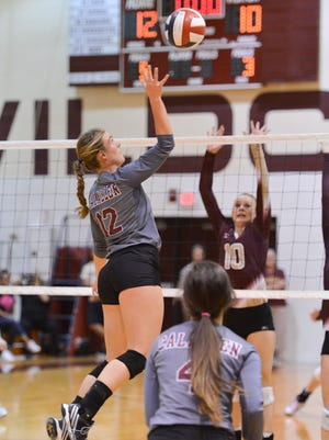 Calallen's Alexis Sacky goes up for a ball during a District 30-5A match against Tuloso-Midway on Tuesday, Oct. 25, 2016.