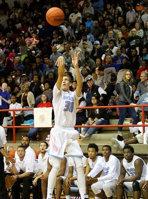 Trae Jones shoots one of his threes Friday night as the Hirschi Huskies took on the Burkburnett bulldogs in 4A action.