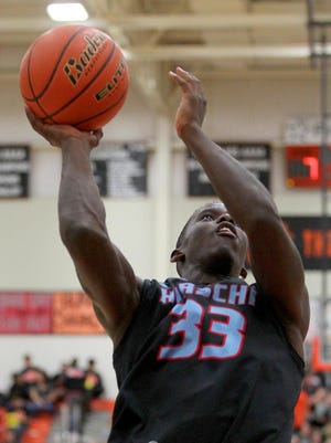 Ezekiel Holmes goes up for the basket Tuesday evening in Burkburnett as the Bulldogs hosted the Huskies in 4A action.