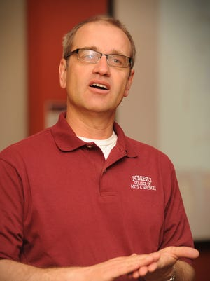 NMSU physics professor Stefan Zollner speaks at a research rally event on campus.
