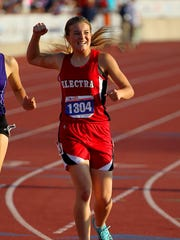 Alexa Daniel of Electra pumps her fist after finishing third  in the 2A girls 400 Saturday.