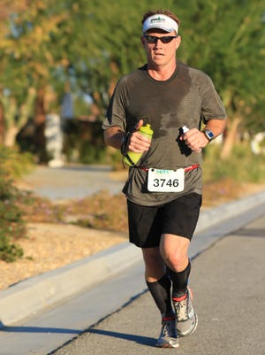 Chuck McArthur, the son of former coach Charlie McArthur, races during the 26-mile run of the Ironman he competed in last December.