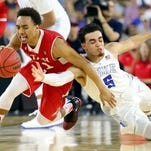 Utah's Brandon Taylor (11) and Duke's Tyus Jones (5) dive for a loose ball in the second half during a South Regional Semifinal game of the 2015 NCAA Men's Basketball Tournament at NRG Stadium on Friday in Houston.