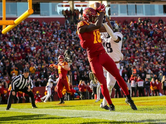 Iowa State Cyclones wide receiver Hakeem Butler (18) catches a touchdown pass in front of TCU Horned Frogs safety Nick Orr (18) during the first half of their game at Jack Trice Stadium Saturday, Oct. 26, 2017.