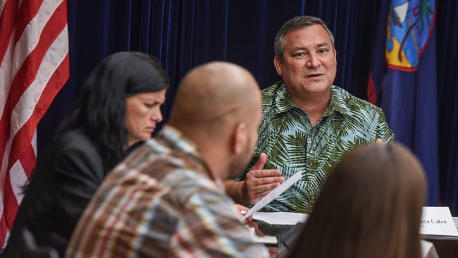Gov. Eddie Calvo addresses commission members and others during a Commission on Decolonization meeting at Adelup on Tuesday, Aug. 1, 2017.