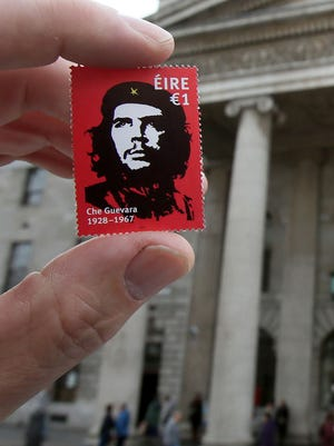 "A stamp, released by Ireland's post office, An Post, featuring an image by Irish artist Jim Fitzpatrick, of Argentine revolutionary leader Ernesto ""Che"" Guevara is held up outside the General Post Office (GPO) in Dublin, Ireland on October 10, 2017."