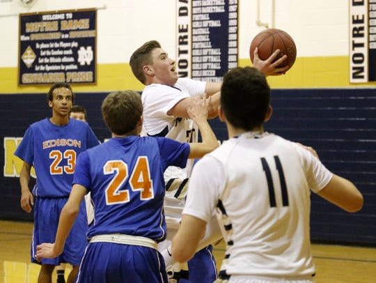 Hunter Homerda of Elmira Notre Dame drives to the basket