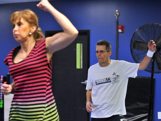 Eagle-Gazette reporter Jeff Barron, right, takes part in an Aerobics/Zumba class Wednesday Jan. 20, 2016, at D'Lean Choice Fit in Lancaster.
