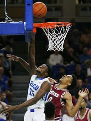 FGCU's Marc-Eddy Norelia scores against the University of Massachusetts on Sunday (12/13/15) at Alico Arena in Fort Myers. Norelia lead FGCU in scoring with 20 points and also had eight rebounds. FGCU beat UMass 77-76.