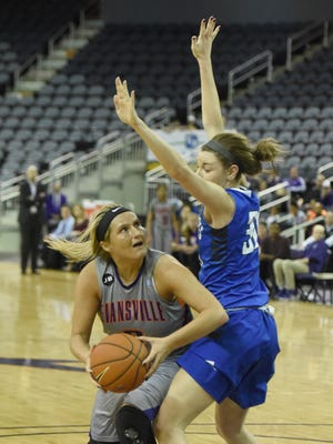 Kerri Gasper of the University of Evansville looks for a way to get around Regan Wentland of Indiana State during the second quarter of the game at the Ford Center in Evansville Friday.