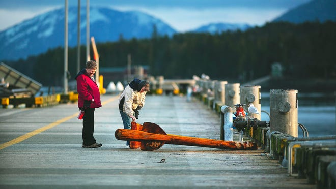 Roseanne and Bob Wickman view an admiralty anchor on Berth 1 in Ketchikan, Alaska, that was recovered in January during the removal of the rock pinnacle.