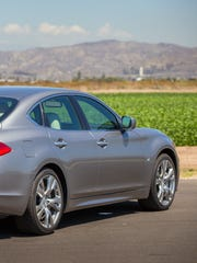 The 2014 Infiniti Q70 is curvaceous, with flared front fenders, fastback roofline and haunched rear flanks.
