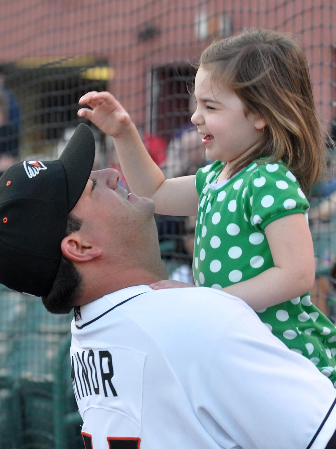 Shorebirds manager Ryan Minor shares a moment with