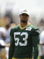 Green Bay Packers linebacker Nick Perry looks on during