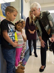 Delaware Secretary of Education, Susan Bunting, meets with pre-kindergarten students Marquise Blake, left, Angely Maza-Lainez and Brigitte Galindo-Mercado during a visit to the George Washington Carver Center in Frankford.