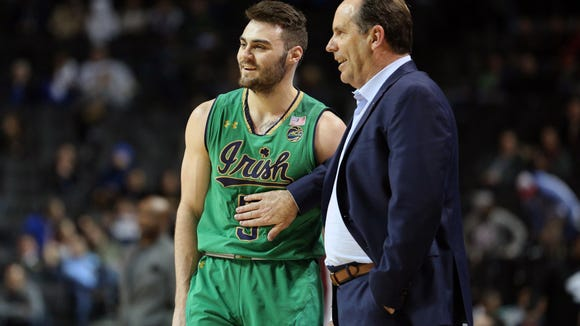 Notre Dame guard Matt Farrell (5) talks with Fighting Irish head coach Mike Bray during the second half of an ACC Tournament game against  Florida State at Barclays Center.