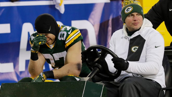 Green Bay Packers wide receiver Jordy Nelson (87) is carted off the field after an injury against the New York Giants in the NFC Wild Card playoff football game at Lambeau Field.