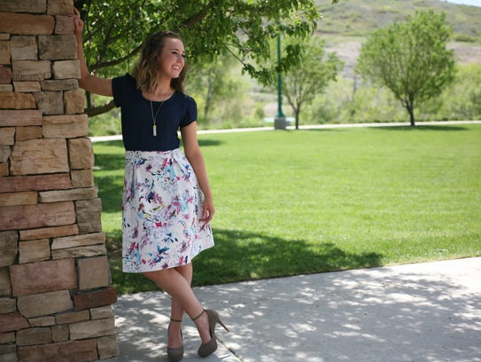 Model poses in skirt and top from modest-fashion website