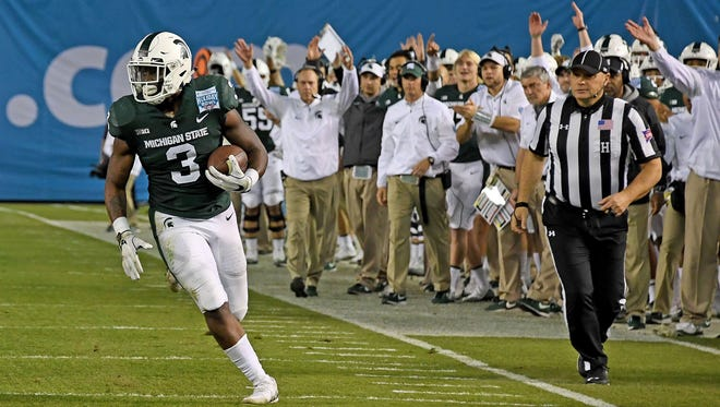 Michigan State running back LJ Scott ran for 110 yards and two touchdowns in Thursday's 41-17 win over Washington State in the Holiday Bowl.