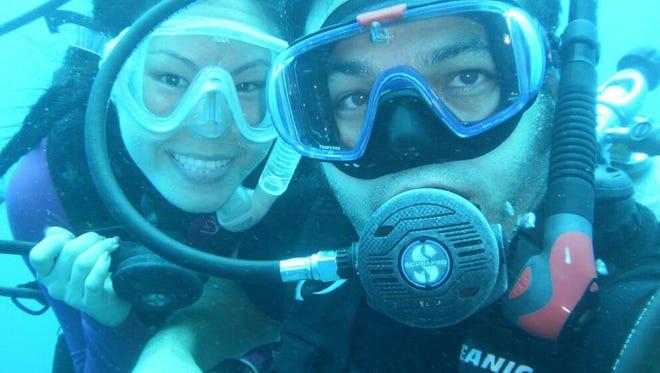 Jason JD Iriarte, right, scuba dives with wife Hannah.