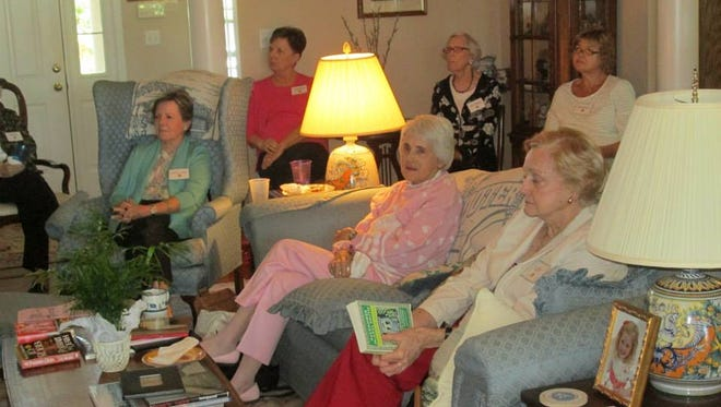 Ladies of the Newcomers Book Club gather for a monthly meeting.