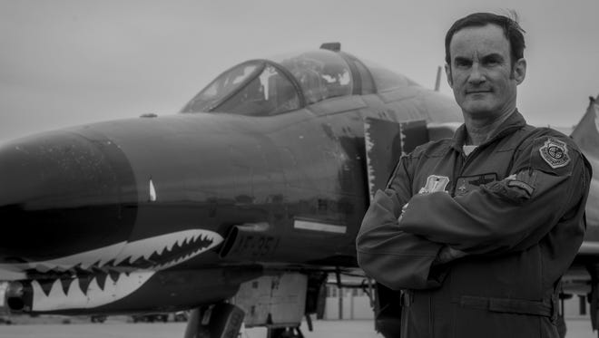 James Harkins, a QF-4 Drone pilot with the 82nd Aerial Targets Squadron, poses for a photo in front of a QF-4 on Oct. 28, 2015 at Holloman Air Force Base. Harkins was the first civilian pilot to fly 1,000 hours in a QF-4, with all of those hours flown as a civilian. He will likely be the last pilot to earn his thousand-hour patch before the QF-4 is officially retired and replaced by the QF-16 at the end of 2016.