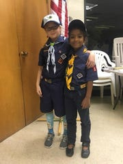Pack 15 is making history. Bear Scout Virginia Tillman (left) and Wolf Scout Arisha Rahman (right) are Pack 15's first girls to complete a Scout Year and participate in the Bridging Ceremony