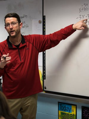 Mon., Jan. 30, 2017: Math teacher Todd Courtney goes over equations in class at Conner Middle School in Hebron.