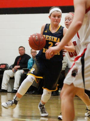 Regina's Mary Crompton drives into the lane during a game against West Branch on Friday, Dec. 18, 2015