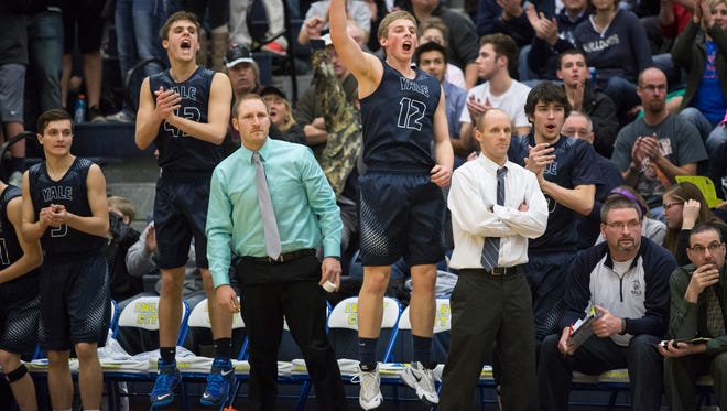 Yale players celebrate on the bench during a basketball game Friday, Feb. 12, 2016 at Imlay City High School.
