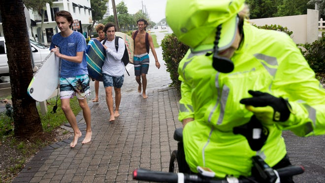 Despite the steady rains residents in Naples made it a point to not let it stop them from going outside around Vanderbilt Beach August 26, 2017 in Naples.