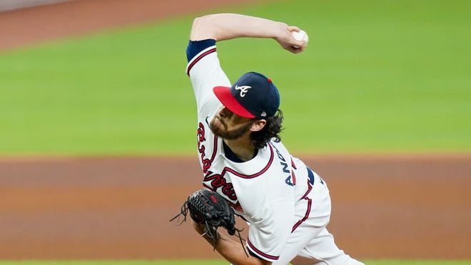 Atlanta Braves' Ian Anderson delivers a pitch during the fourth inning in Game 2 of a baseball National League Division Series against the Miami Marlins Wednesday, Oct. 7, 2020, in Houston.