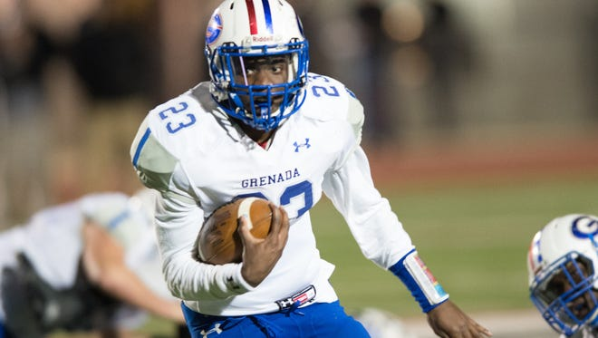 Grenada's Demarquese Gibson runs the ball against Germantown in a first round MHSAA 5A playoff game on Friday.