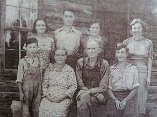 Posing at the log cabin in 1938 were Gracie (top row, from left), Arthur, Pansy and   Esther; Frankie (front row, from left), Nora, John and Johnny.