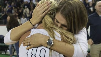 Manasquan's Dara Mabrey gets hugs from her coach Lisa Kukoda after their TOC win. Manasquan Girls Basketball vs Franklin in NJSIAA TOC Finals game in Trenton NJ on March 17, 2018