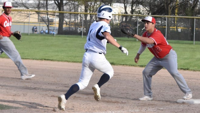 The throw to Canton first baseman Lou Baechler (right) is in time to retire Livonia Stevenson runner Jacob Way (1) during Monday's  contest.
