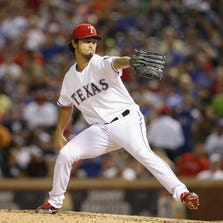 Jul 28, 2014; Arlington, TX, USA; Texas Rangers starting pitcher Yu Darvish (11) throws during the game against the New York Yankees at Globe Life Park in Arlington. Mandatory Credit: Kevin Jairaj-USA TODAY Sports
