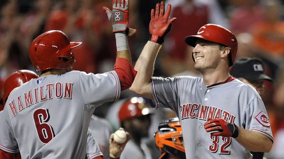 Jay Bruce and Billy Hamilton celebrate Bruce's grand slam.