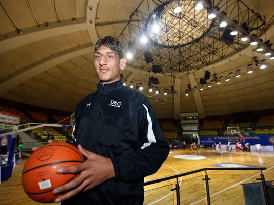 FILE - In this Jan. 2, 2011, file photo, Indian teenager Satnam Singh poses with a basketball at the Talkatora Stadium in New Delhi, India. At 7-foot-2 and nearly 300 pounds, the Dallas Mavericks made Singh the NBA's first Indian-born draft pick and believe he can have a future in the NBA.   (AP Photo/Mustafa Quraishi, File)