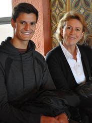 Colin Cole sits with his host mother from Germany.
