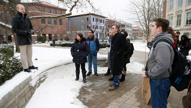 """Garen Bragg, left, addresses students gathered for a rallly against sexualy assault Monday, February 15, 2016, in front of Hovde Hall on the campus of Purdue University. """"Sexually explicit threats have no place on campus,"""" Bragg said."""