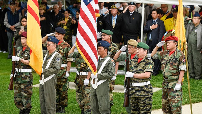 Honor Guard members bring in the colors at the start of the Memorial Day program by the Vietnamese community of St. Cloud and the Vietnam Veterans of America Chapter 290 on Saturday, May 28, 2016, at the Lake George Vietnam War Memorial in St. Cloud.