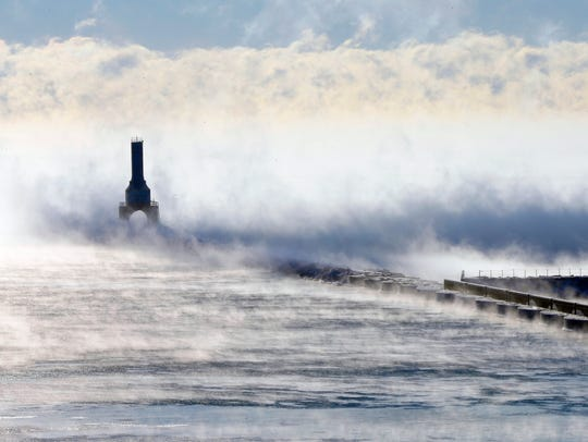 Steam rises around the Port Washington Lighthouse on