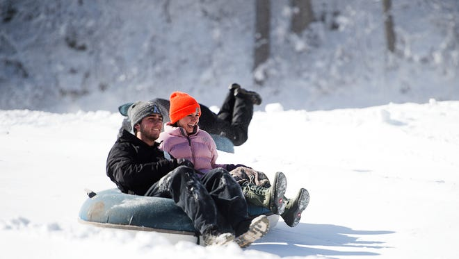 Appalachian State students Hanna Long and Noah Finnegan laugh while tubing down a hill Sunday Jan. 8, 2017 at Tube World in Maggie Valley.